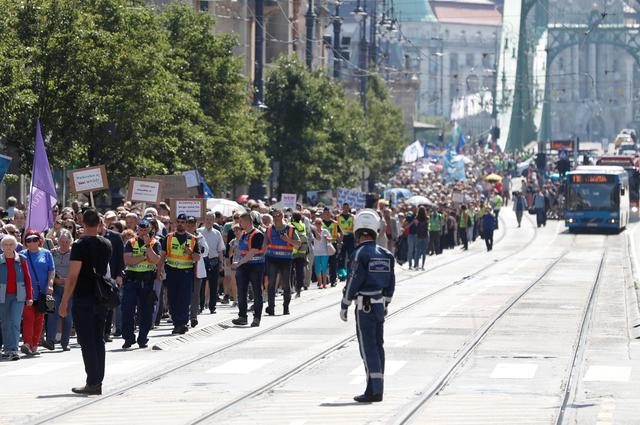 FILE PHOTO: People march in Budapest during a protest against government plans to overhaul the Hungarian Academy of Sciences, June 2, 2019. REUTERS/Bernadett Szabo/File Photo