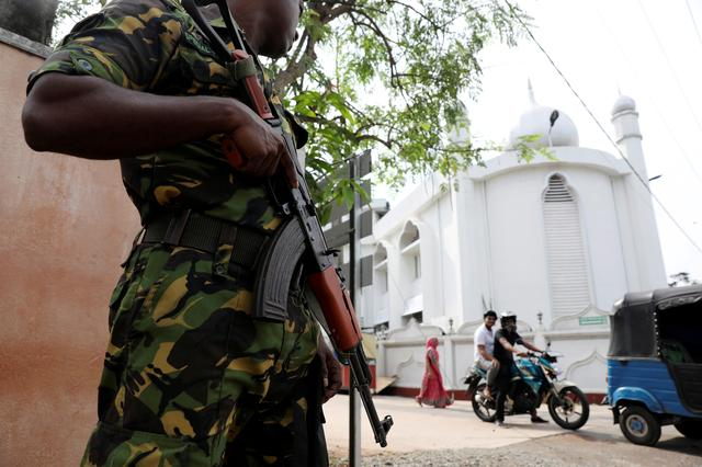 FILE PHOTO: A soldier stands guard outside the Grand Mosque, days after a string of suicide bomb attacks on churches and luxury hotels across the island on Easter Sunday, in Negombo, Sri Lanka April 26, 2019, -