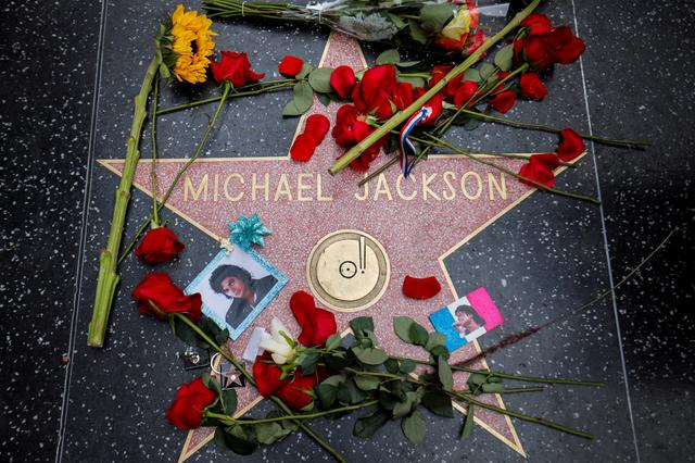 FILE PHOTO: Flowers surround Michael Jackson's star on the Hollywood Walk of Fame ten years after the death of child star turned King of Pop in Los Angeles, California, U.S., June 25, 2019. REUTERS/Mike Blake/File Photo
