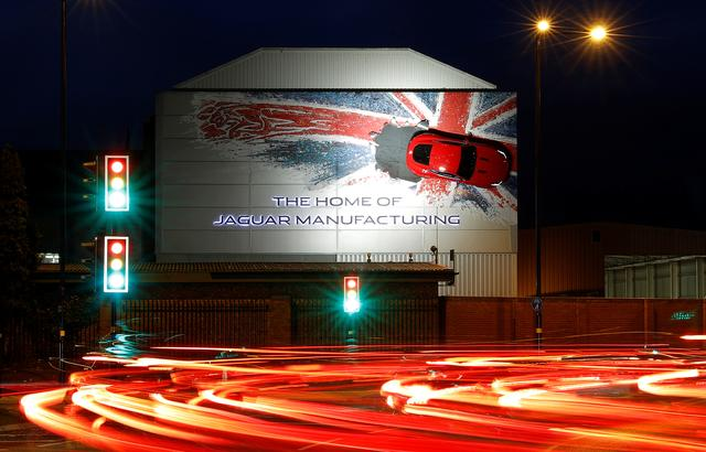 FILE PHOTO - A car hangs on the wall of Jaguar's Castle Bromwich manufacturing facility in Birmingham, Britain, November 17, 2016.  REUTERS/Darren Staples