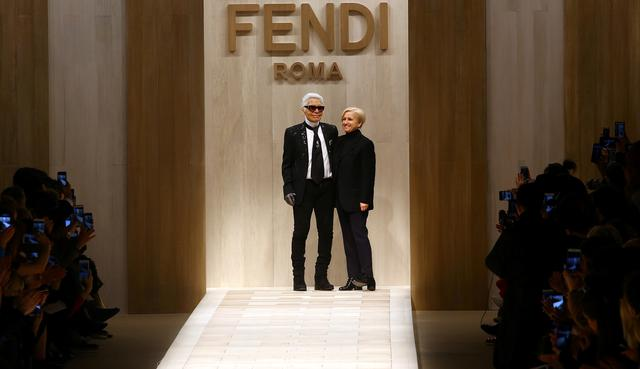FILE PHOTO: Designers Karl Lagerfeld (L) and Silvia Venturini Fendi acknowledge the applause at the end of their fashion show during Milan's Fashion Week, in Milan, Italy February 23, 2017.  REUTERS/Stefano Rellandini
