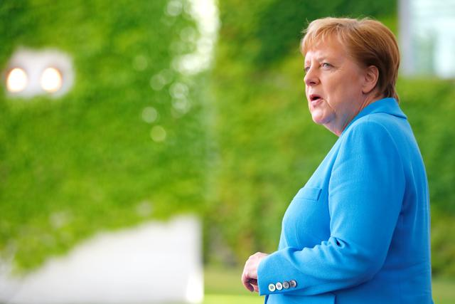 FILE PHOTO - German Chancellor Angela Merkel waits for Ireland's President Michael D. Higgins to arrive at the Chancellery in Berlin, Germany July 3, 2019. REUTERS/Hannibal Hanschke