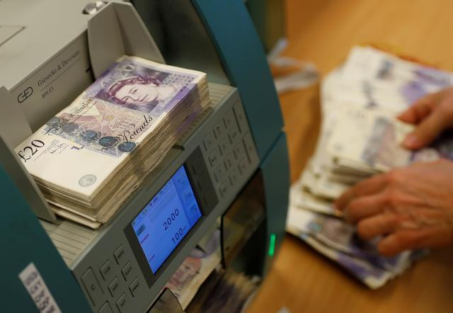 British Pound Sterling banknotes are seen in a counter machine at the Money Service Austria company's headquarters in Vienna, Austria, November 16, 2017. REUTERS/Leonhard Foeger