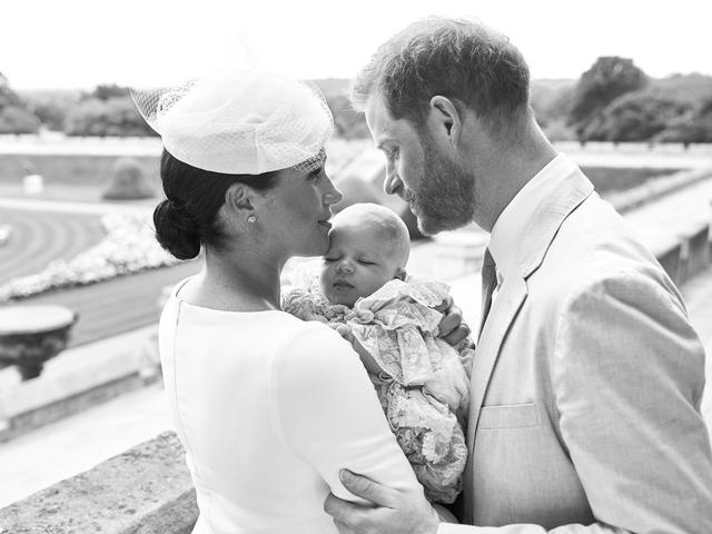 This official christening photograph released by the Duke and Duchess of Sussex shows Prince Harry, Duke of Sussex and Meghan, Duchess of Sussex with their son, Archie Harrison Mountbatten-Windsor at Windsor Castle with with the Rose Garden in the background, near London, Britain July 6, 2019. Chris Allerton/Pool via REUTERS