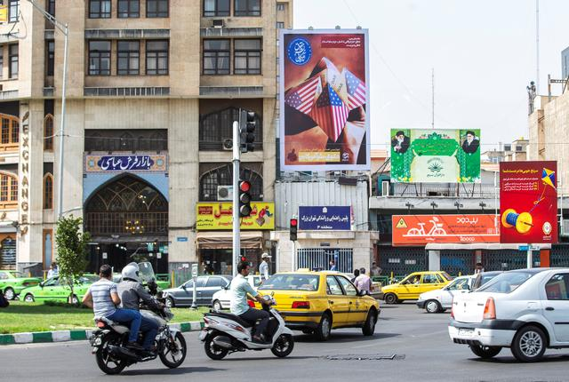 A general view of Ferdowsi Square showing an anti-U.S. mural in Tehran, Iran July 6, 2019. Picture taken July 6, 2019. Nazanin Tabatabaee/ WANA (West Asia News Agency) via REUTERS