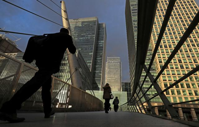 FILE PHOTO: People walk through the Canary Wharf financial district of London, Britain, December 7, 2018. REUTERS/Simon Dawson/File Photo
