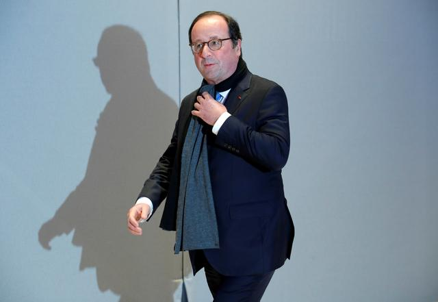 FILE PHOTO - Former French President Francois Hollande arrives to attend the 34th annual dinner of the Representative Council of Jewish Institutions of France (CRIF - Conseil Representatif des Institutions juives de France) in Paris, France February 20, 2019. REUTERS/Philippe Wojazer