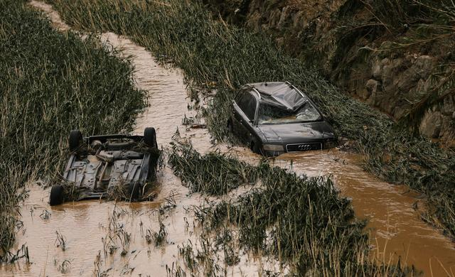 Cars are seen in the river bank after heavy rainfall in Tafalla, Spain, July 9, 2019. REUTERS/Susana Vera