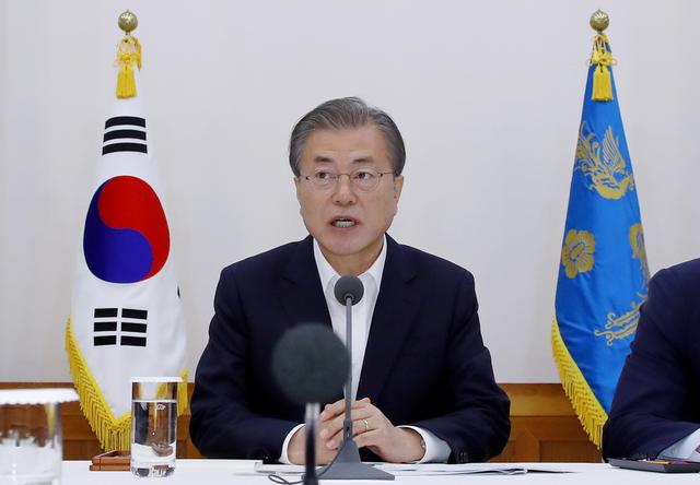 South Korean President Moon Jae-in speaks during a meeting with executives from South Korea's top 30 conglomerates at the Presidential Blue House in Seoul, South Korea, July 10, 2019.    Yonhap via REUTERS