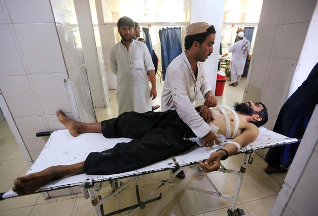 An injured man receives treatment at the hospital, after a suicide attack in Jalalabad, Afghanistan July 12, 2019. REUTERS/Parwiz
