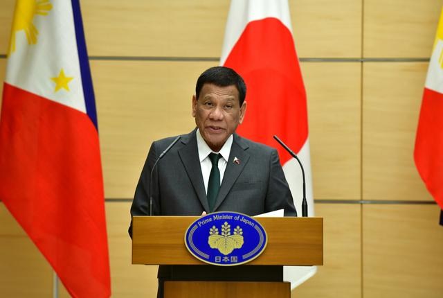 FILE PHOTO: Philippine President Rodrigo Duterte delivers a speech during their joint press statement with Japan's Prime Minister Shinzo Abe (not pictured) at Abe's official residence in Tokyo, Japan May 31, 2019.  Kazuhiro Nogi /Pool via Reuters