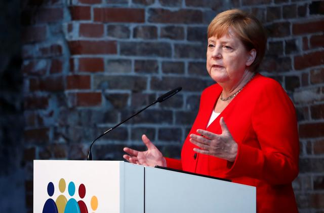 FILE PHOTO: German Chancellor Angela Merkel speaks during a ceremony to mark 50 years of German development aid in Berlin, Germany, July 12, 2019. REUTERS/Hannibal Hanschke