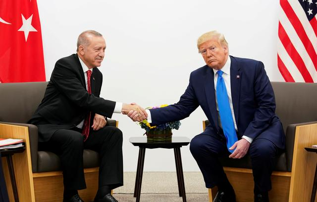 FILE PHOTO: U.S. President Donald Trump shakes hands during a bilateral meeting with Turkey's President Tayyip Erdogan during the G20 leaders summit in Osaka, Japan, June 29, 2019. REUTERS/Kevin Lamarque