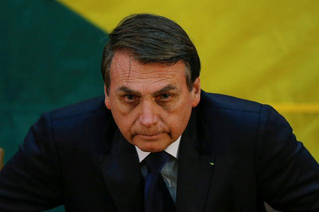 FILE PHOTO: Brazil's President Jair Bolsonaro attends in an inauguration ceremony of the new general director of the Brazilian Intelligence Agency (ABIN) in Brasilia, Brazil July 11, 20109. REUTERS/Adriano Machado