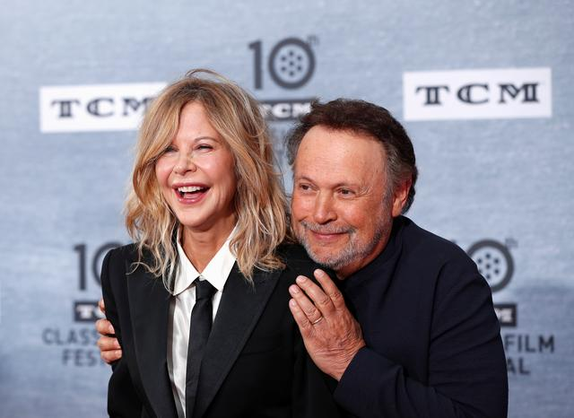 "Cast members Billy Crystal and Meg Ryan pose as they arrive for the 30th anniversary screening of comedy movie ""When Harry Met Sally"" in Hollywood, California, U.S. April 11, 2019. REUTERS/Mario Anzuoni"