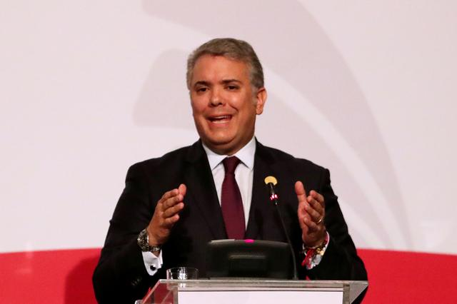FILE PHOTO: Colombia's President Ivan Duque speaks during the 4th Pacific Alliance Summit in Lima, Peru July 6, 2019. REUTERS/Guadalupe Pardo