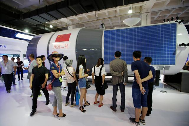 FILE PHOTO: A model of Tiangong 2 space laboratory by China Aerospace Science and Technology Corporation is displayed at China Beijing International High-tech Expo in Beijing, China June 8, 2017. REUTERS/Jason Lee