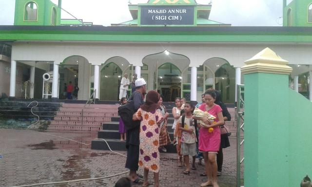 People gather outside a mosque following an earthquake at Labuha in South Halmahera, North Maluku, Indonesia, July 14, 2019 in this photo taken by Antara Foto. Antara Foto via REUTERS