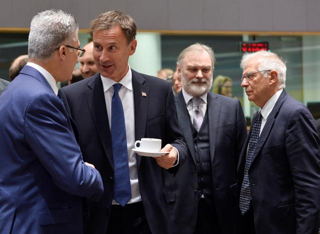 Malta's Foreign Minister Carmelo Abela talks with his British counterpart Jeremy Hunt during a EU foreign ministers meeting in Brussels, Belgium July 15, 2019. REUTERS/Johanna Geron