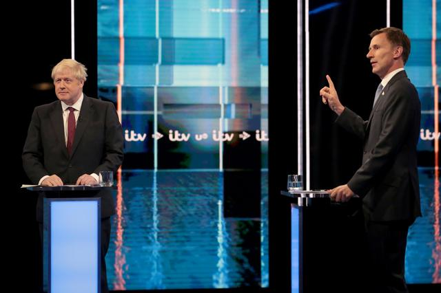 FILE PHOTO:  Boris Johnson and Jeremy Hunt, leadership candidates for Britain's Conservative Party, attend Britain's Next Prime Minister: The ITV Debate at MediaCityUK in Salford, Britain July 9, 2019. Matt Frost/ITV/Handout via REUTERS