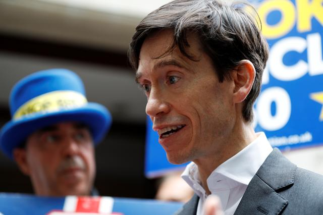 FILE PHOTO: PM hopeful Rory Stewart speaks to the media as he emerges from TV studios in Westminster, London, Britain, June 19, 2019. REUTERS/Peter Nicholls