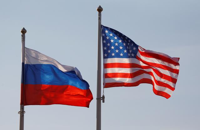National flags of Russia and the U.S. fly at Vnukovo International Airport in Moscow, Russia April 11, 2017.  REUTERS/Maxim Shemetov
