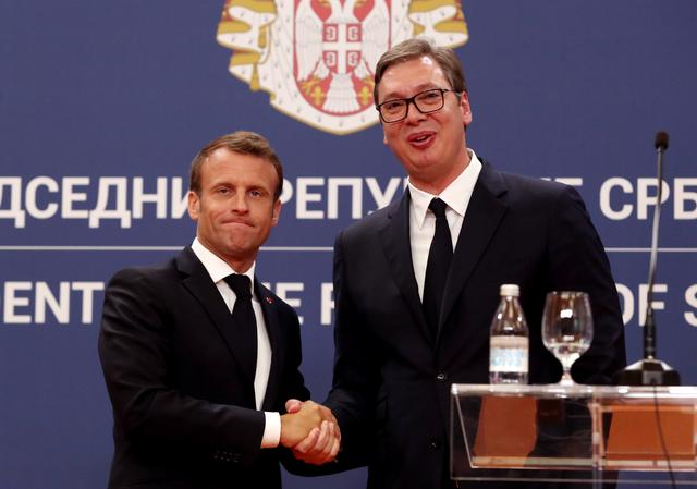 French President Emmanuel Macron and Serbian President Aleksandar Vucic shake hands after a joint news conference at the Serbia Palace building in Belgrade, Serbia, July 15, 2019. REUTERS/Djordje Kojadinovic