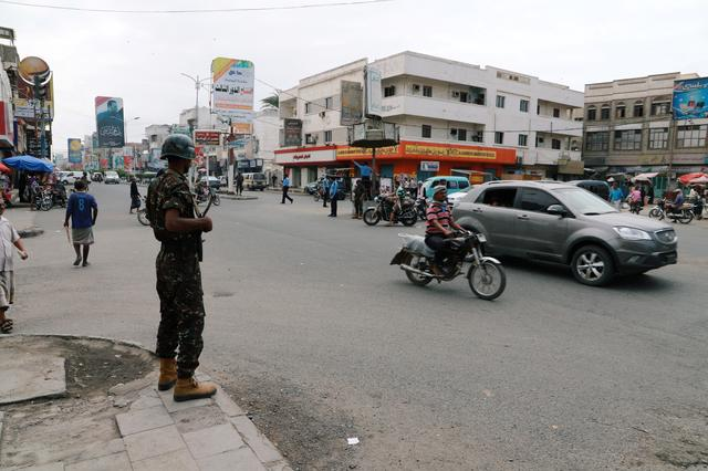 FILE PHOTO: Police trooper stands guard on a street in the Red Sea port city of Hodeidah, Yemen February 13, 2019. REUTERS/Abduljabbar Zeyad