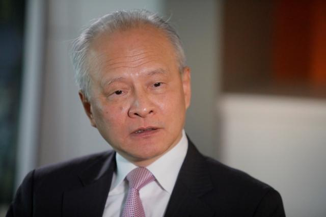 FILE PHOTO: China's ambassador to the United States Cui Tiankai responds to reporters questions during an interview with Reuters in Washington, U.S., November 6, 2018. REUTERS/Jim Bourg/File Photo