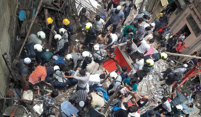 Rescue workers and residents search for survivors at the site of a collapsed building in Mumbai, India, July 16, 2019. REUTERS/Stringer