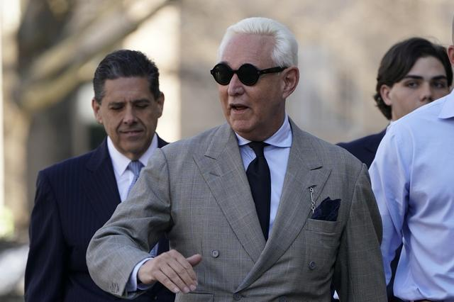 FILE PHOTO - Roger Stone, longtime political ally of U.S. President Donald Trump, waves as he arrives for a status hearing in the criminal case against him brought by Special Counsel Robert Mueller at U.S. District Court in Washington, U.S., March 14, 2019. REUTERS/Joshua Roberts