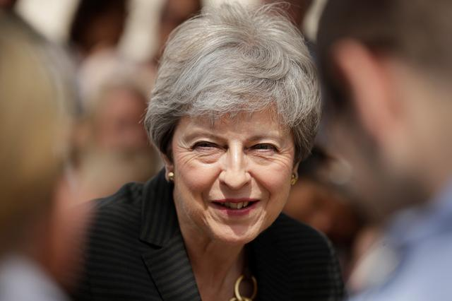FILE PHOTO: Britain's Prime Minister Theresa May meets military service personnel and their families at headquarters of Joint Forces Command in Northwood, London, Britain July 8, 2019. Matt Dunham/Pool via REUTERS