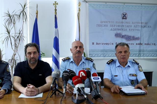 Crete's Chief of Police Konstantinos Lagoudakis (C), Chania Police Chief Giorgos Libinakis (R) and Director of Security for Chania Police Paris Chinopoulos are seen during a news conference, presenting the latest developments on the murder of American biologist Suzanne Eaton, in Chania, on the island of Crete, Greece July 16, 2019. REUTERS/Makis Kartsonakis