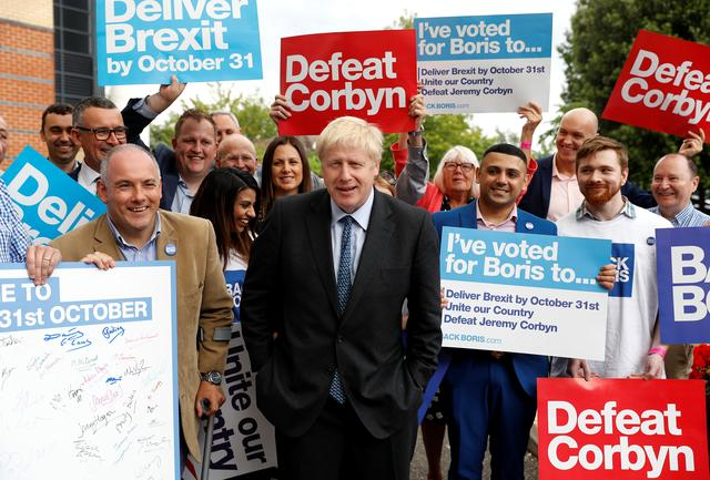 FILE PHOTO: Boris Johnson, a leadership candidate for Britain's Conservative Party, arrives to attend a hustings event in Colchester, Britain July 13, 2019. REUTERS/Peter Nicholls