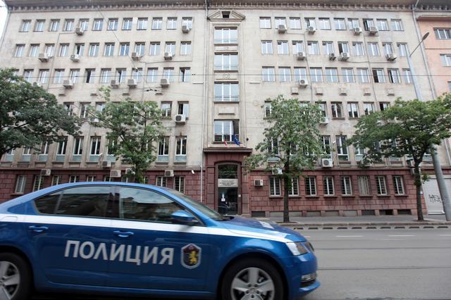 A police car passes past Bulgaria's National Revenue Agency building in Sofia, Bulgaria, July 16, 2019. REUTERS/Dimitar Kyosemarliev