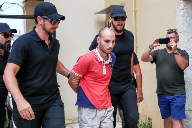 Plain-clothes police officers escort the suspect (C) for the murder of American biologist Suzanne Eaton to the prosecutor in Chania, on the island of Crete, Greece, July 16, 2019. REUTERS/Makis Kartsonakis