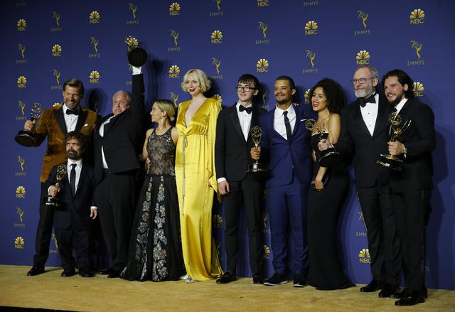"FILE PHOTO - 70th Primetime Emmy Awards - Photo Room - Los Angeles, California, U.S., 17/09/2018 - The cast poses backstage with the Outstanding Drama Series award for ""Game of Thrones."" REUTERS/Mike Blake"
