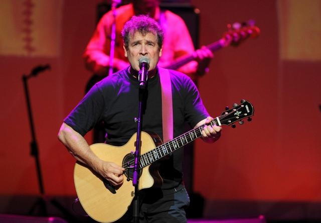 FILE PHOTO: South African singer Johnny Clegg performs during the South Africa Gala night at the Monte Carlo opera, September 29, 2012. REUTERS/Sebastien Nogier/Pool/File Photo