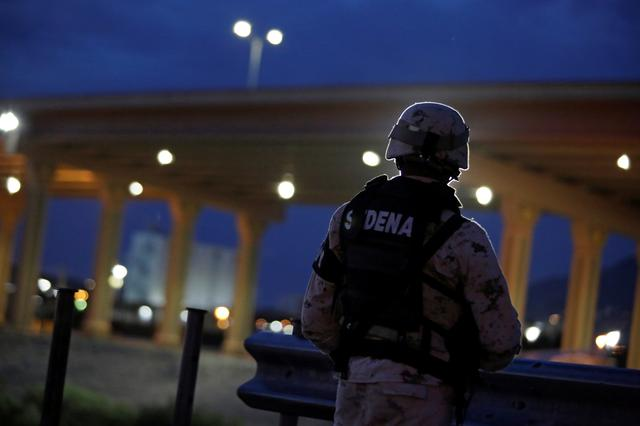 A member of the Mexican National Guard keeps watch near the border between Mexico and U.S., as seen from Ciudad Juarez, Mexico July 14, 2019. REUTERS/Daniel Becerril