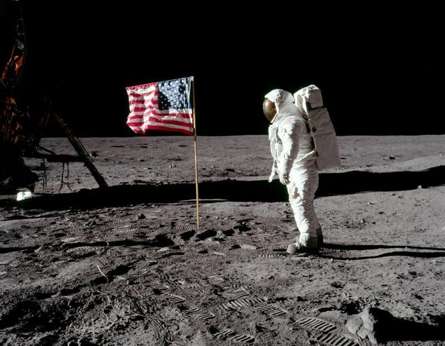 FILE PHOTO: Astronaut Buzz Aldrin, lunar module pilot for Apollo 11, poses for a photograph besides the deployed United States flag during an extravehicular activity (EVA) on the moon, July 20, 1969. The lunar module (LM) is on the left, and the footprints of the astronauts are visible in the soil. Neil Armstrong/NASA/Handout via REUTERS