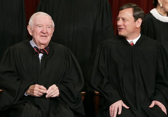 Chief Justice John Roberts poses for a 2006 class photo inside the Supreme Court in Washington March 3, 2006.   REUTERS/Larry Downing