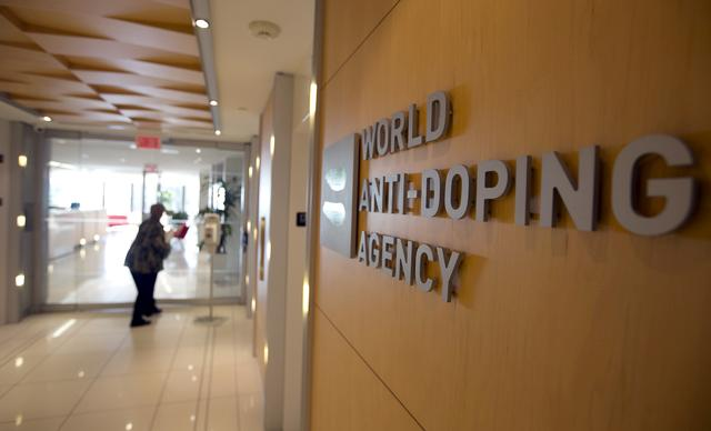 FILE PHOTO: A woman walks into the head office of the World Anti-Doping Agency (WADA) in Montreal, Quebec, Canada November 9, 2015.  REUTERS/Christinne Muschi