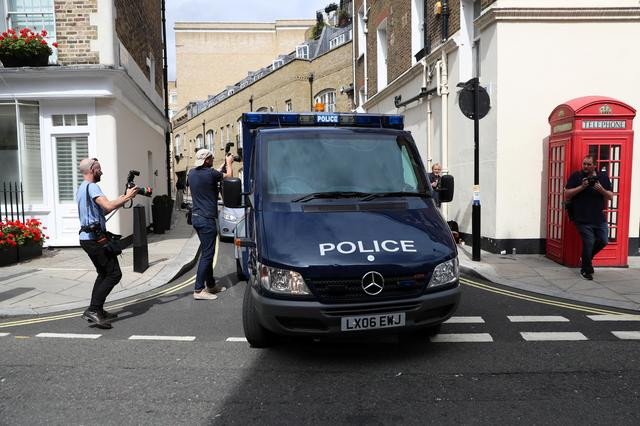 FILE PHOTO: A police van, believed to be carrying Sudanese-born British national Salih Khater, leaves Westminster Magistrates' Court in London, Britain August 20, 2018. REUTERS/Simon Dawson