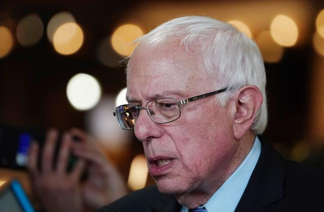 "FILE PHOTO: Senator Bernie Sanders is interviewed in the ""spin room"" after the conclusion of the second night of the first U.S. 2020 presidential election Democratic candidates debate in Miami, Florida, U.S., June 27, 2019. REUTERS/Carlo Allegri"