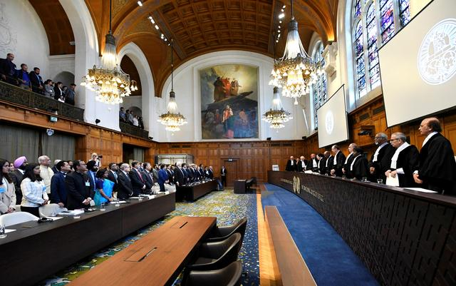 Judges are seen at the International Court of Justice before the issue of a verdict in the case of Indian national Kulbhushan Jadhav who was sentenced to death by Pakistan in 2017, in The Hague, Netherlands July 17, 2019. REUTERS/Piroschka van De Wouw