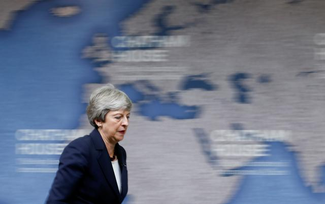Britain's Prime Minister Theresa May walks out of stage after delivering a speech at Chatham House in London, Britain July 17, 2019. REUTERS/Henry Nicholls/Pool