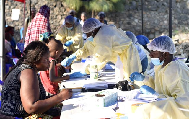 Congolese health workers collect data before administering ebola vaccines to civilians at the Himbi Health Centre in Goma, Democratic Republic of Congo, July 17, 2019. REUTERS/Olivia Acland