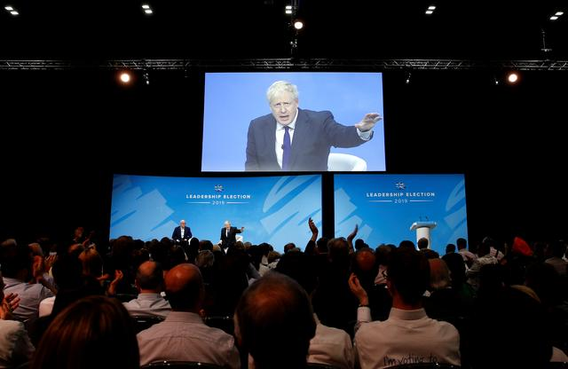 FILE PHOTO: Boris Johnson, a leadership candidate for Britain's Conservative Party, speaks during a hustings event in London, Britain July 17, 2019. REUTERS/Peter Nicholls/File Photo