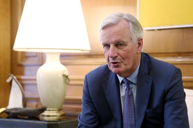 FILE PHOTO: EU chief Brexit negotiator Michel Barnier speaks with Greek Prime Minister Alexis Tsipras (not pictured) at the Maximos Mansion in Athens, Greece, May 21, 2019. REUTERS/Costas Baltas/File Photo