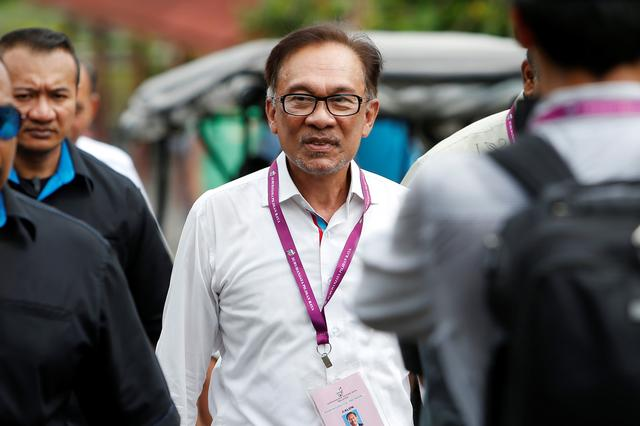 FILE PHOTO: Malaysia's politician Anwar Ibrahim visits a polling station during the by-election in Port Dickson, Malaysia October 13, 2018. REUTERS/Lai Seng Sin/File Photo